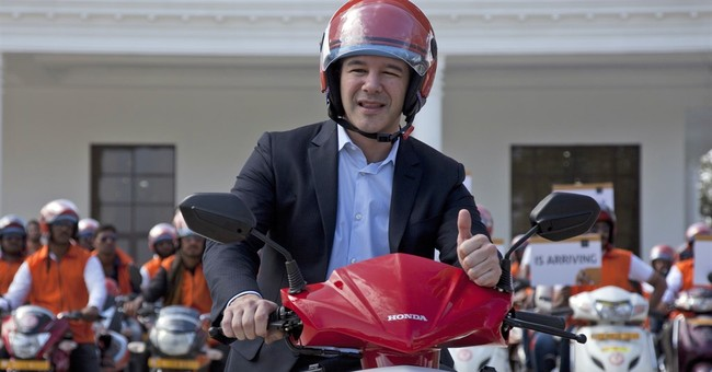 Drivers rebel against Uber's price-cutting quest for growth