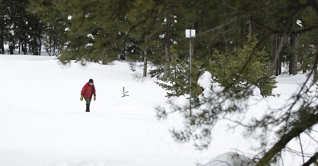 The Latest: California snowpack nearing record depths