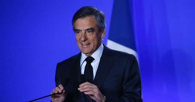 Fillon vows to stay in French race amid defections