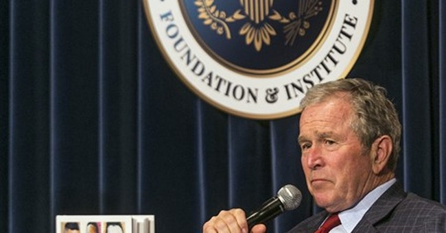 George W. Bush warns against 'isolationist tendency' in US
