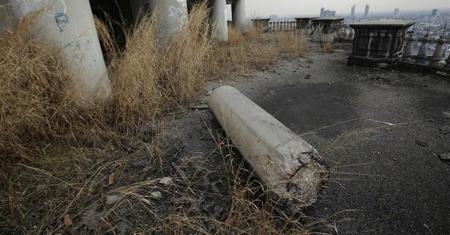 """Ghost Tower"" haunts Bangkok 20 years after financial crisis"
