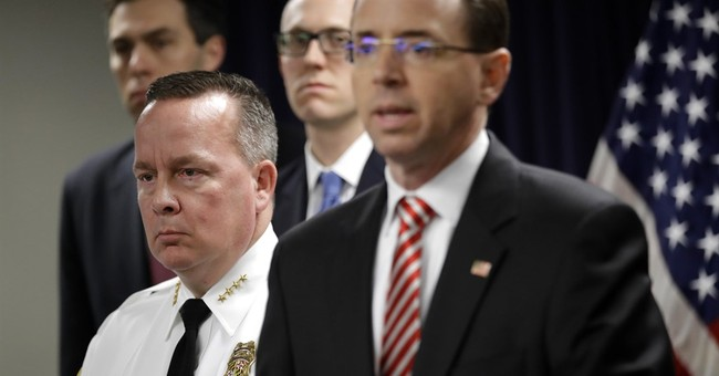 The Latest: Feds drop 5 cases brought by arrested officers