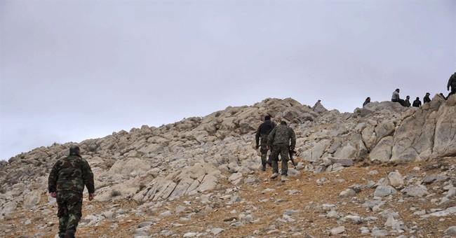 Syrian army retakes town of Palmyra as IS defenses crumble