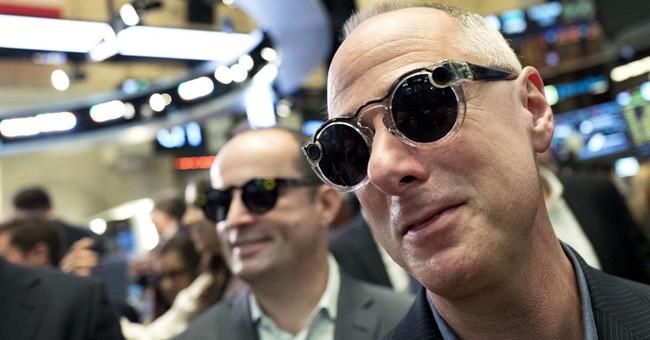 Asian shares lower as investors await Fed chair's speech
