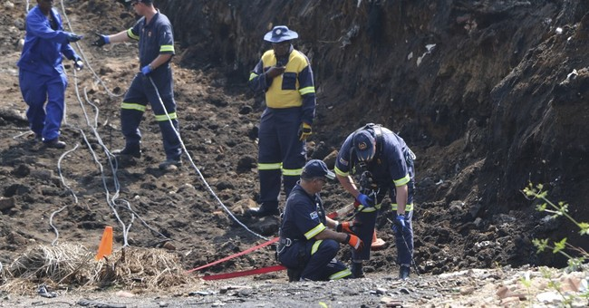 South African rescuers look for boy who fell into mine shaft