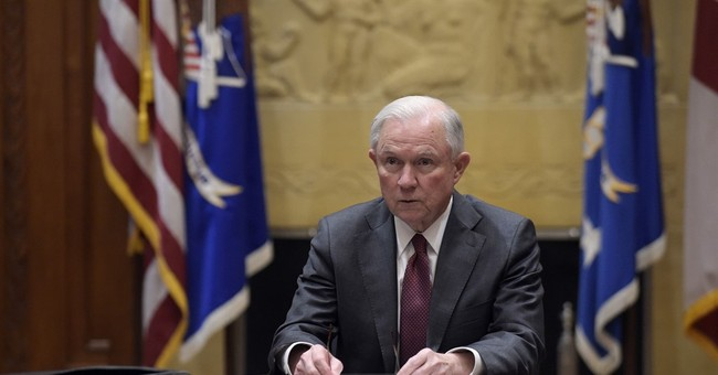 Sessions steps aside from Russia probe under pressure
