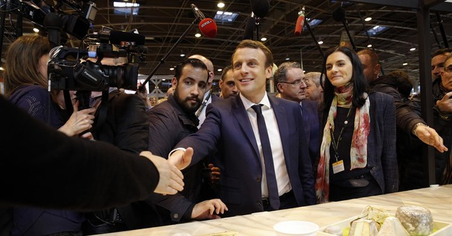 France candidate Macron lifts veil on presidential platform