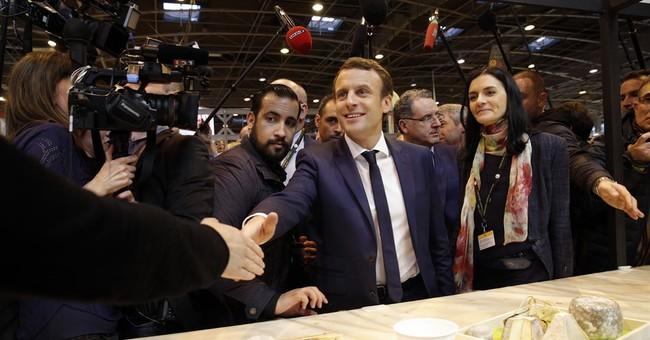 France candidate Macron lifts veil on presidential platform