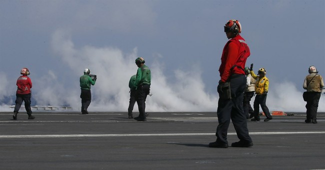 Top Philippine officials fly to US carrier in disputed sea