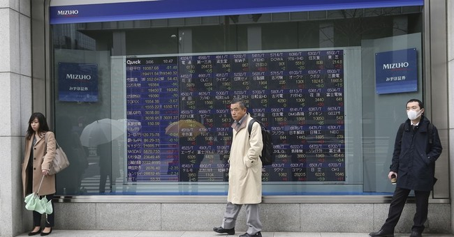 Asian shares mostly higher despite pullback on Wall Street