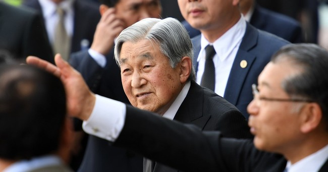 Japan's emperor pays respects to Thailand's late king