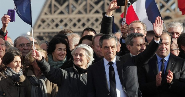 Fillon clings to French presidential race; party not sure