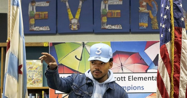 Rapper gives $1 million to Chicago schools, blasts governor