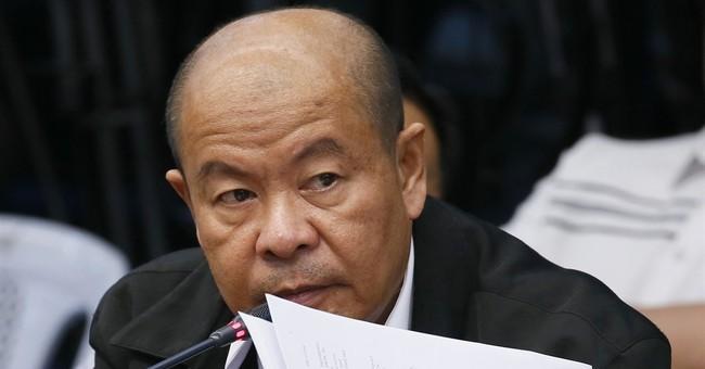 Ex-cop links Philippine leader to killings in Senate inquiry
