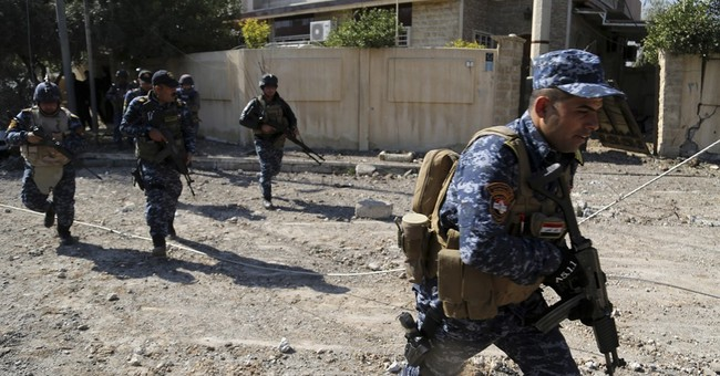 Iraqi forces storm Mosul government complex, hoist flag