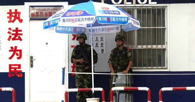 Restive Chinese region offers rewards to recruit more police