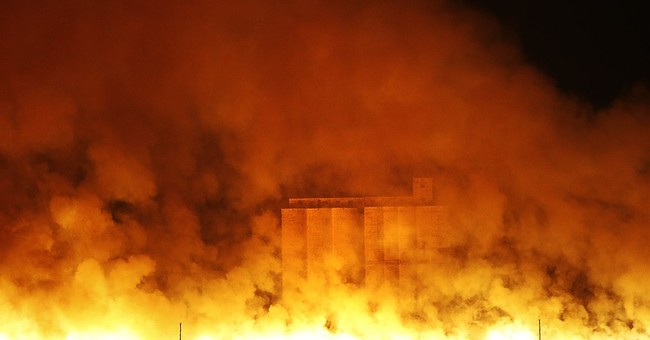 Wildfires in 4 states kill 6, force thousands from homes