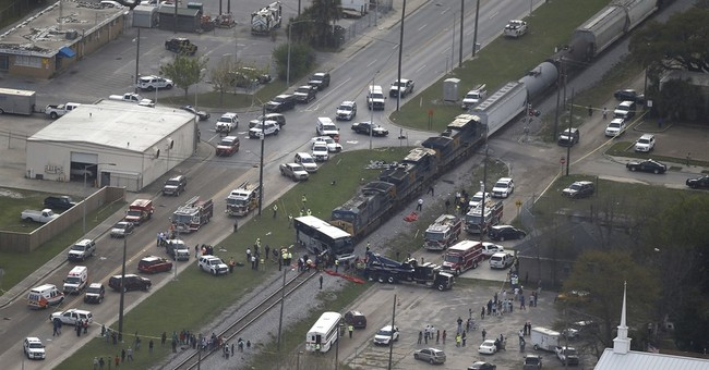 Train hits bus, killing 4 passengers on senior center trip