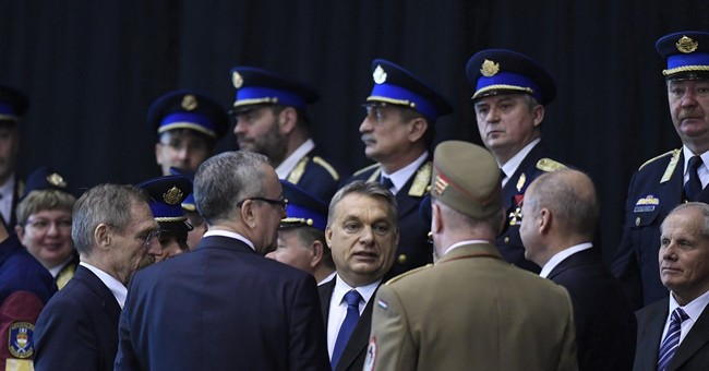 Hungary blasted for rule detaining refugees in containers