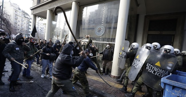Greek farmers protesting tax hikes fight police in Athens