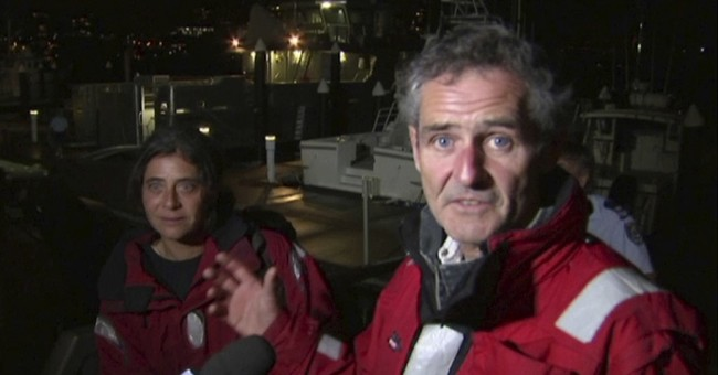 2 rescued from capsized yacht in heavy seas off Australia