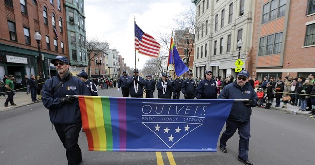 The Latest: Parade organizers say gay group not banned