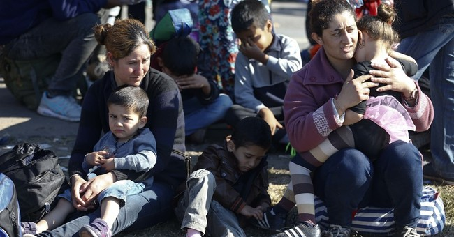 Hungarian leader defends new asylum law criticized by UN