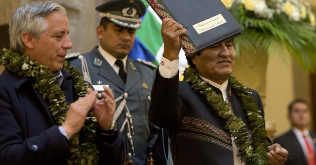 Bolivia's Morales approves coca law after treatment in Cuba