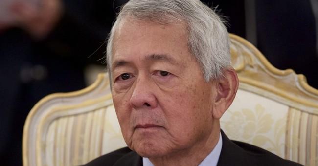 Philippine top diplomat loses job over US passport