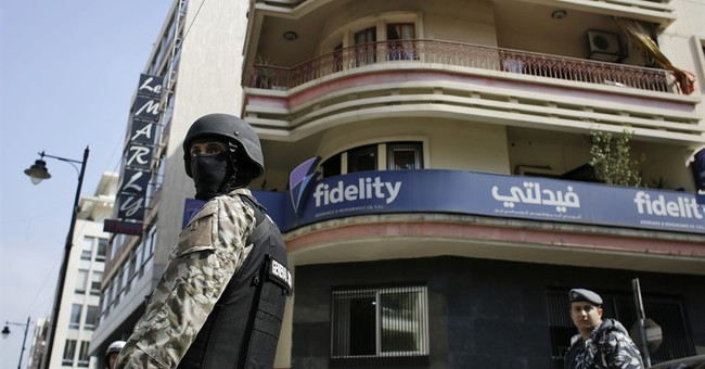 Lebanese security forces raid money transfer shops in Beirut