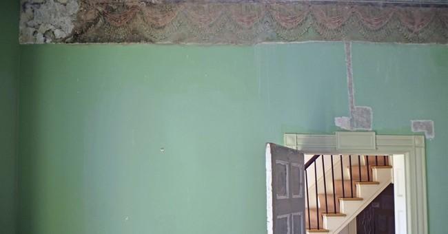 Hidden beneath paint, a famed artist's wall decorations