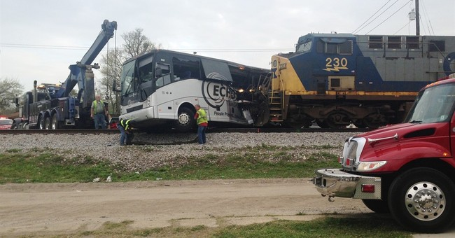 The Latest: NTSB: Fatal rail crossing not on tour bus route