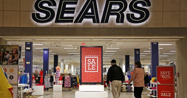 Sears, watching its spending, limits 4Q adjusted loss