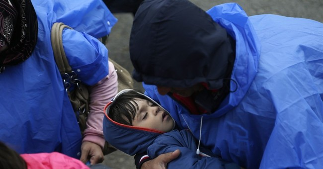 The Latest: Hungary defends new asylum law criticized by UN