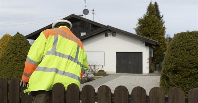 German police arrest woman, seek man over double killing