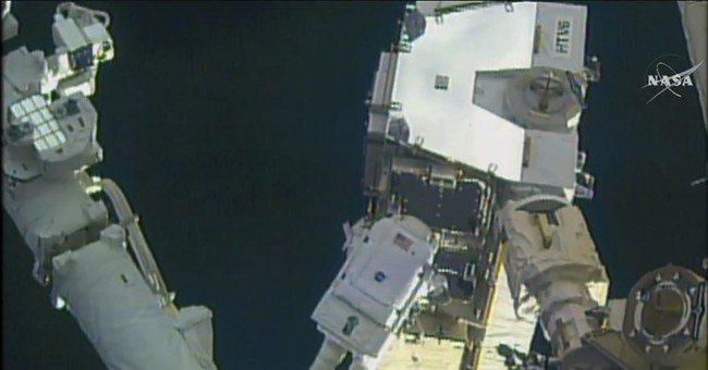 Spacewalking astronauts upgrade station with new batteries