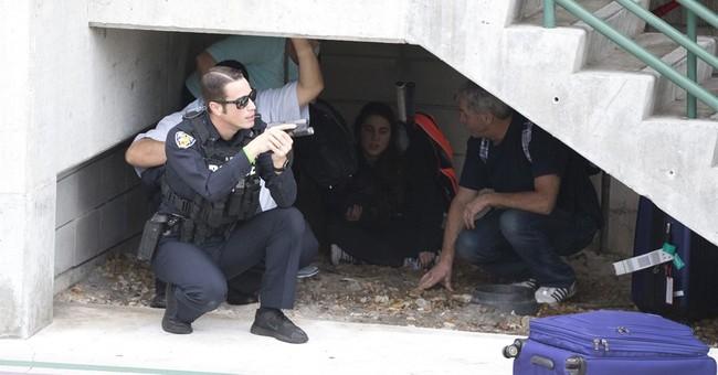 Airport gunman charged, US seeks death penalty
