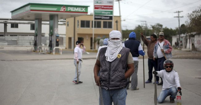 Mexicans march against gas price hike, little looting