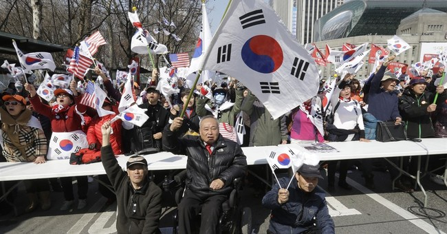 S.Koreans celebrate Park's removal, but ousted leader silent