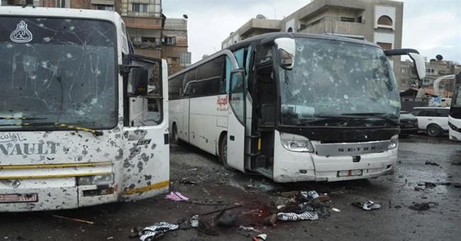 The Latest: Iraq FM: 40 Iraqis killed in Damascus blasts