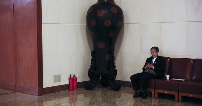 AP PHOTOS: Fire extinguishers at China's Great Hall