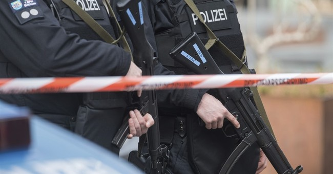 German police release second man held over mall threat