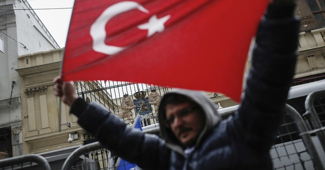 The Latest: French candidate Macron condemns Turkey