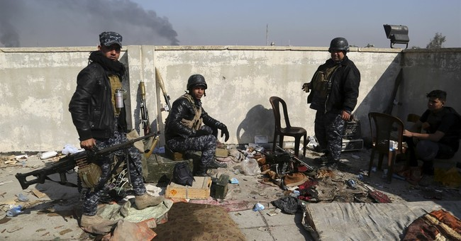 Coalition official: IS-held Mosul completely surrounded