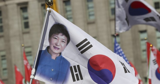 The Latest: Ousted South Korean leader denies wrongdoing