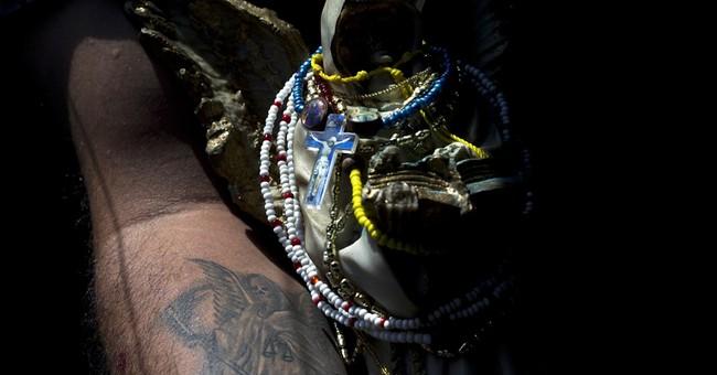 AP PHOTOS: Death Saint draws followers in Mexico