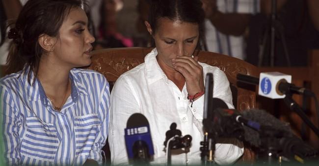 Indonesia sentences Brit, Aussie to prison in cop's death