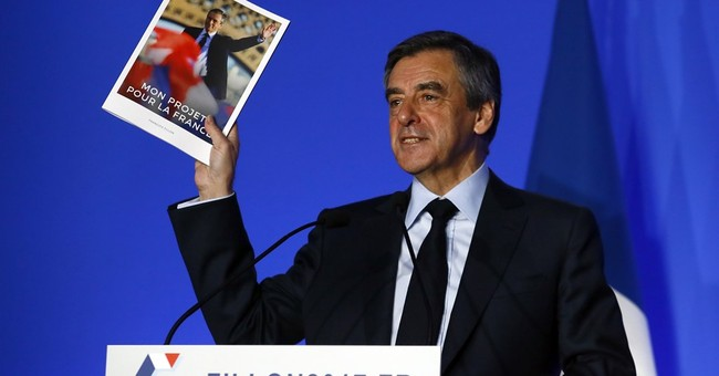 French candidate Fillon on defensive over suits, caricature