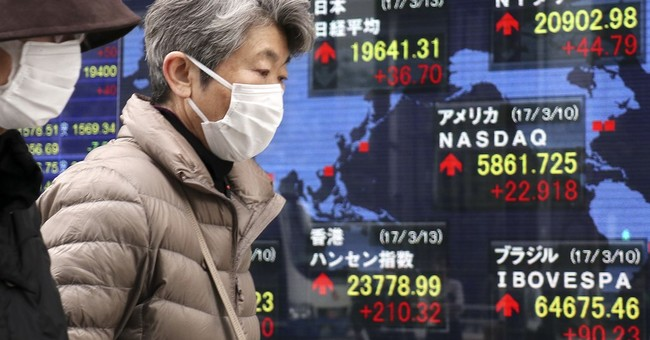 Global stocks eke out modest gains at start of busy  week