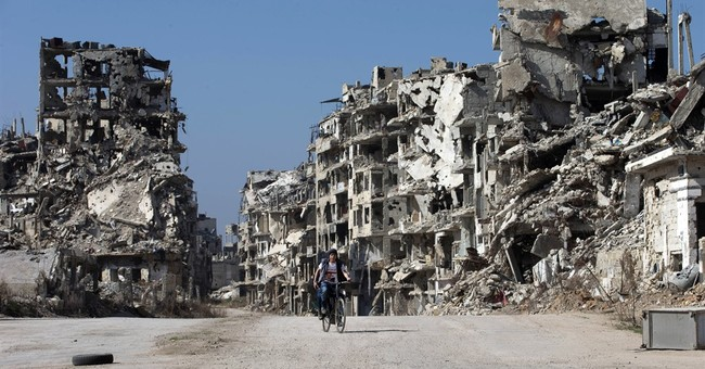 In Syria, deal struck to allow rebels to leave city of Homs